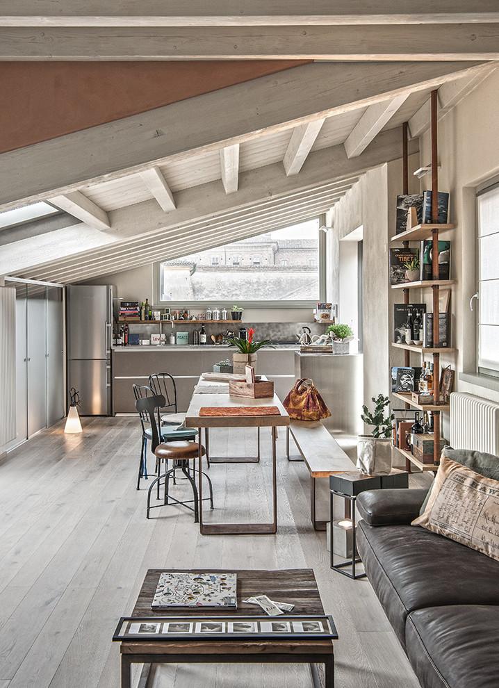 Urban light wood floor and gray floor great room photo in Milan with beige walls