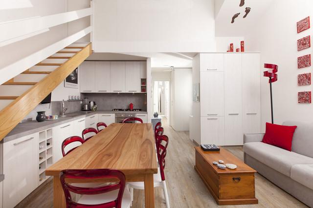 Salotto con cucina a vista e zona pranzo moderno sala da pranzo milano di semprelegno - Arredare sala con cucina a vista ...