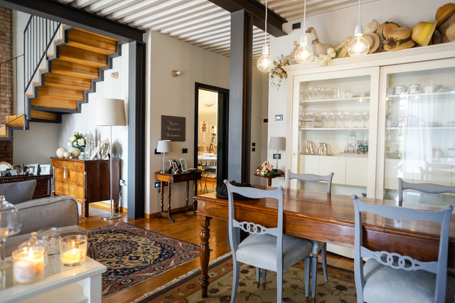 Design ideas for a medium sized rural dining room in Milan with white walls and medium hardwood flooring.
