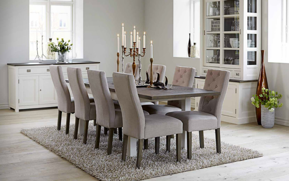 Inspiration for a mid-sized transitional light wood floor enclosed dining room remodel in Strasbourg with white walls