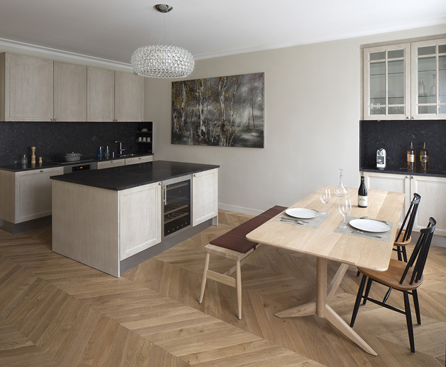 Mid-sized transitional medium tone wood floor kitchen/dining room combo photo in Paris with beige walls