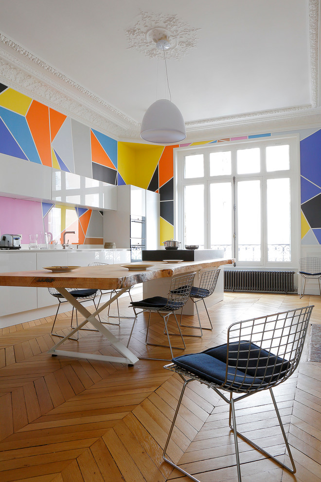 Example of a mid-sized trendy medium tone wood floor great room design in Paris with multicolored walls
