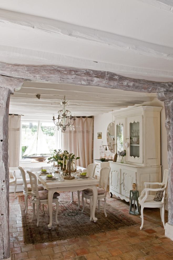 Dining room - french country dining room idea in Paris with white walls and no fireplace