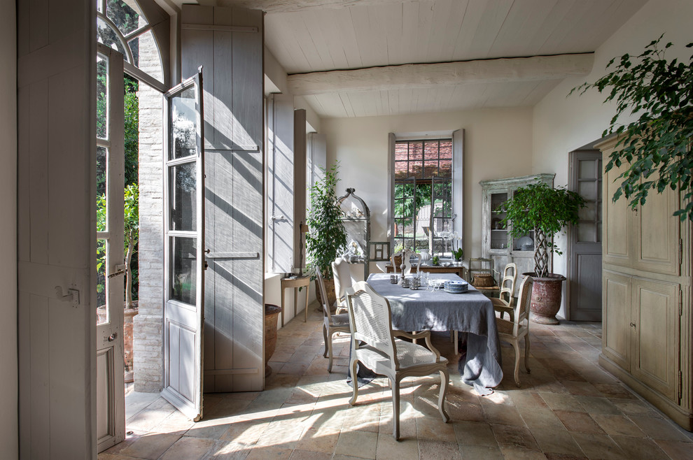 Large cottage terra-cotta tile enclosed dining room photo in Nice with white walls and no fireplace