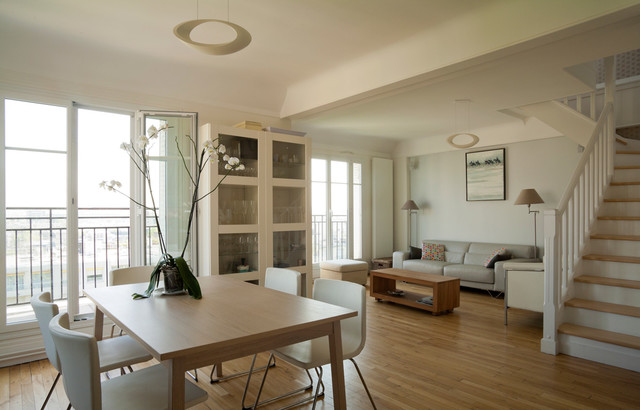 Trendy Medium Tone Wood Floor Dining Room Photo In Paris With White Walls