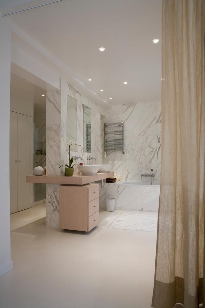 Drop-in bathtub - large contemporary master drop-in bathtub idea in Paris with multicolored walls and a vessel sink