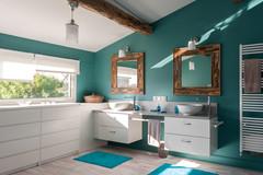 """Avant/Après : Un grenier transformé en un """"salon de bains"""" cosy"""