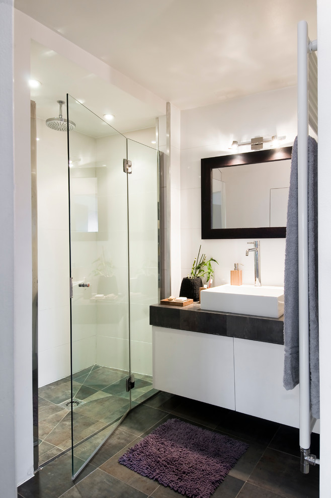 Walk-in shower - mid-sized contemporary 3/4 ceramic tile walk-in shower idea in Paris with white cabinets, white walls, a vessel sink and tile countertops