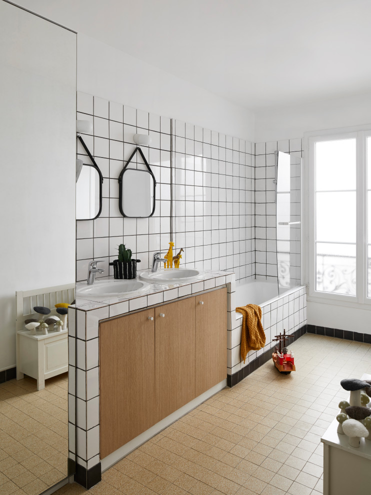 Inspiration for a large contemporary kids' white tile brown floor and double-sink bathroom remodel in Paris with flat-panel cabinets, medium tone wood cabinets, white walls, a drop-in sink, multicolored countertops and a built-in vanity