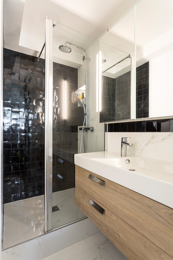 Walk-in shower - small scandinavian 3/4 black and white tile and marble tile marble floor and white floor walk-in shower idea in Paris with light wood cabinets, white walls, a trough sink, a wall-mount toilet, a hinged shower door and flat-panel cabinets