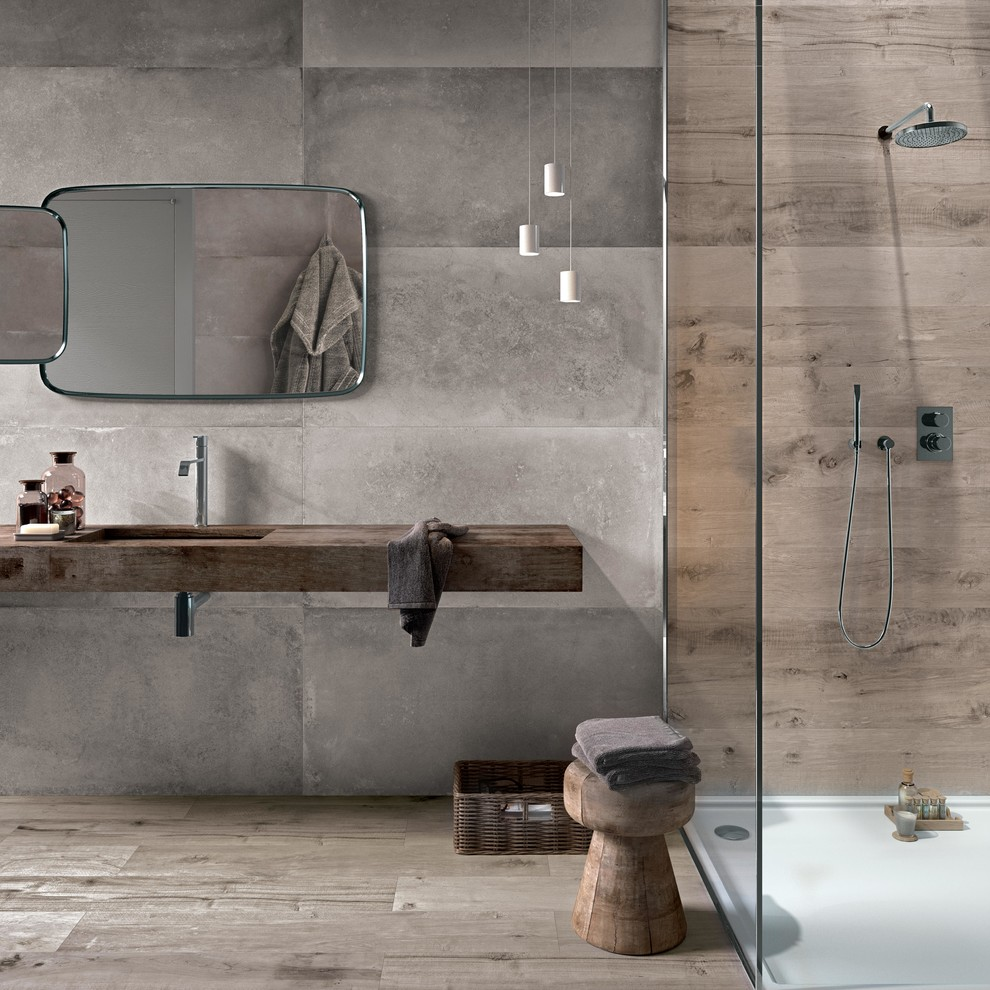 Bathroom - contemporary master gray tile and cement tile medium tone wood floor bathroom idea in Toulouse with gray walls, an undermount sink, wood countertops and brown countertops