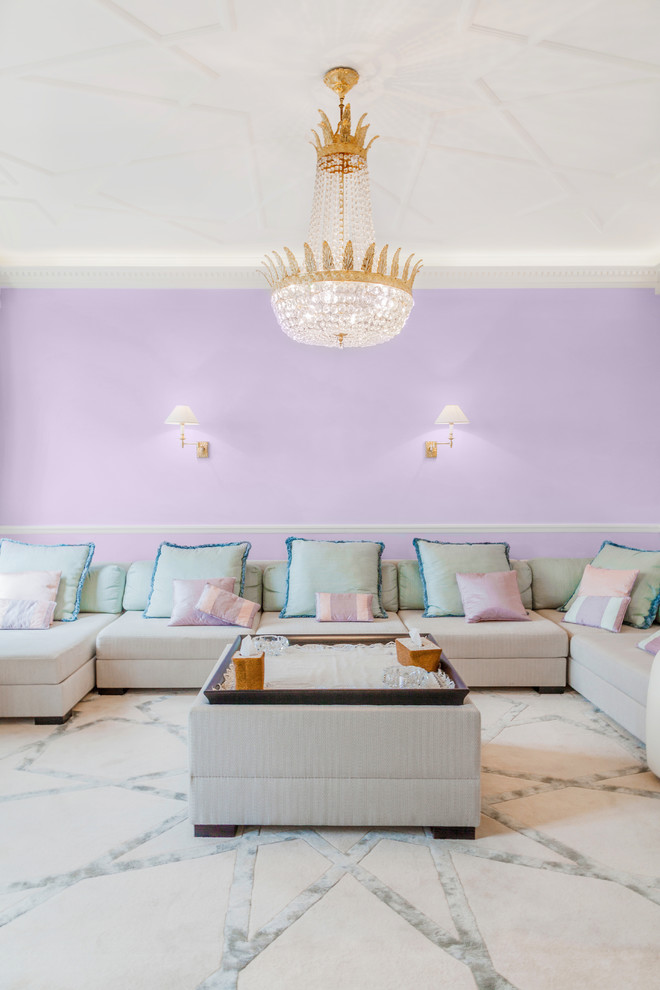 Example of a transitional family room design in Paris with purple walls