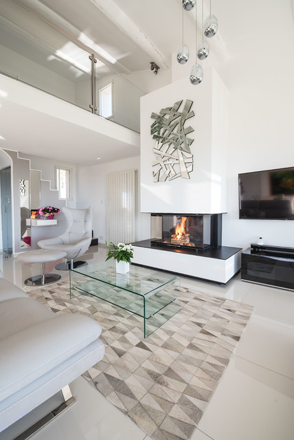 Inspiration for a contemporary enclosed beige floor family room remodel in Marseille with a standard fireplace, a plaster fireplace, white walls and a wall-mounted tv