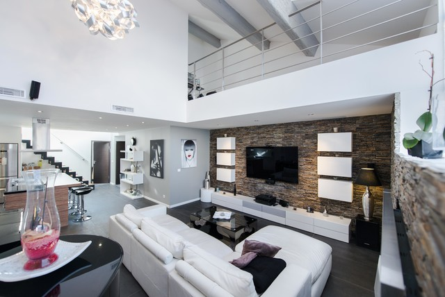 Inspiration for a large contemporary open concept family room remodel in Other with white walls and a wall-mounted tv