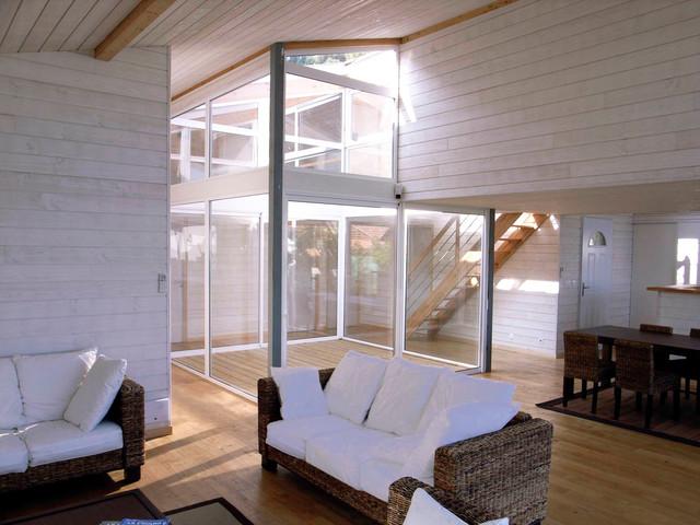 Maison ossature métallique et bois  Beach Style  Family Room  other metro
