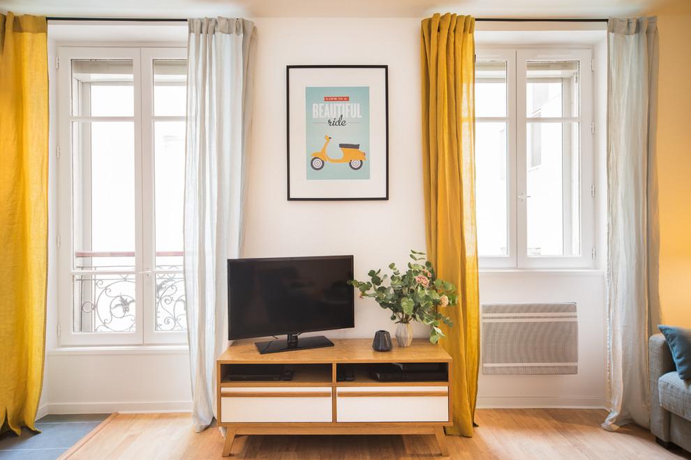 Example of a danish family room design in Paris