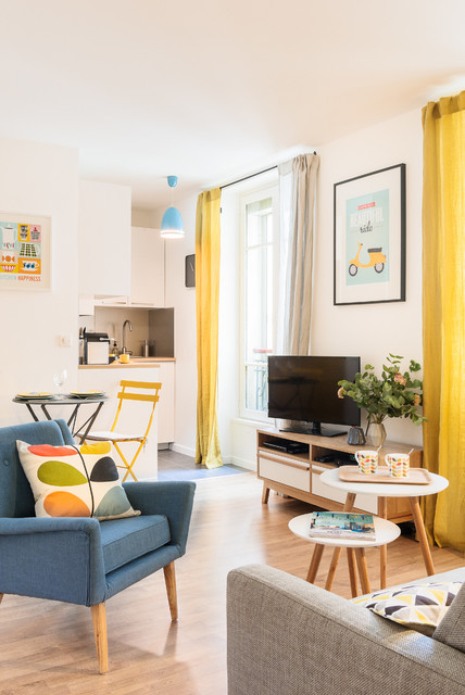 Family room - small scandinavian open concept light wood floor family room idea in Paris with white walls and a tv stand