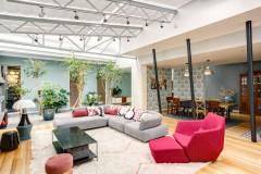 Visite Privée : Un loft parisien aux pièces de vie rénovées