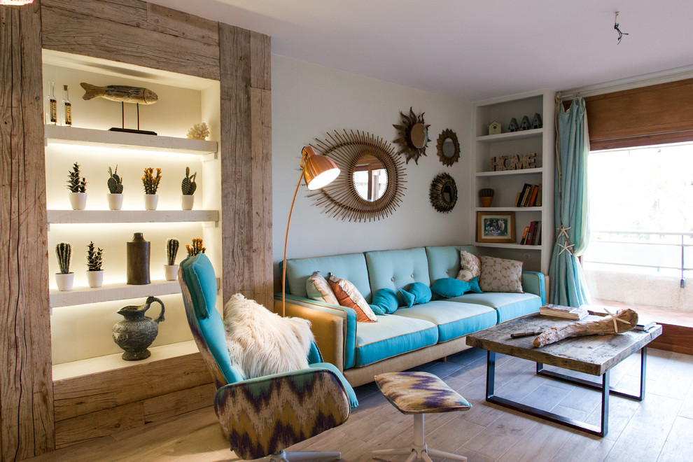 Inspiration for a coastal formal and enclosed medium tone wood floor and beige floor living room remodel in Other with gray walls