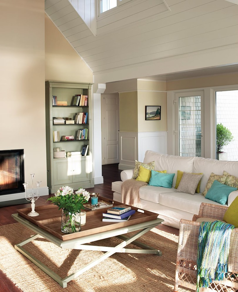 Example of a mid-sized classic formal and open concept dark wood floor living room design in Other with beige walls, a standard fireplace, a metal fireplace and a tv stand