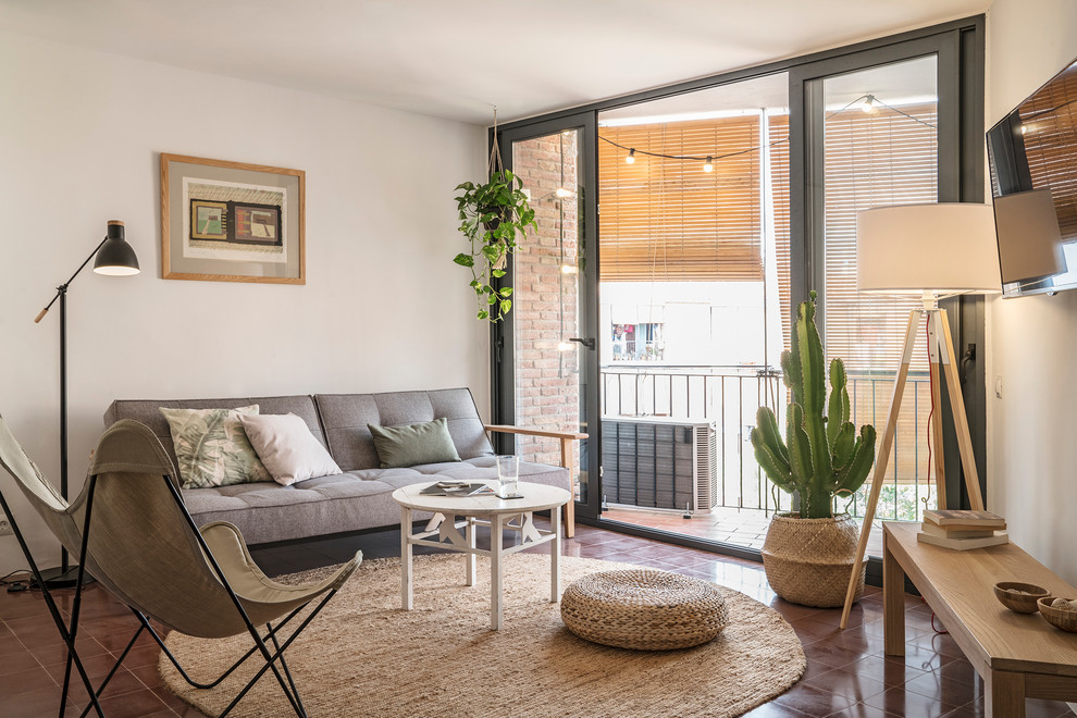 Small transitional open concept living room photo in Barcelona with white walls