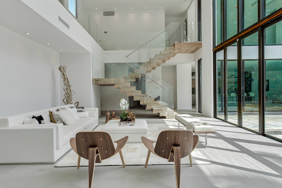 Inspiration for a contemporary formal and open concept gray floor living room remodel in Miami with white walls and no fireplace