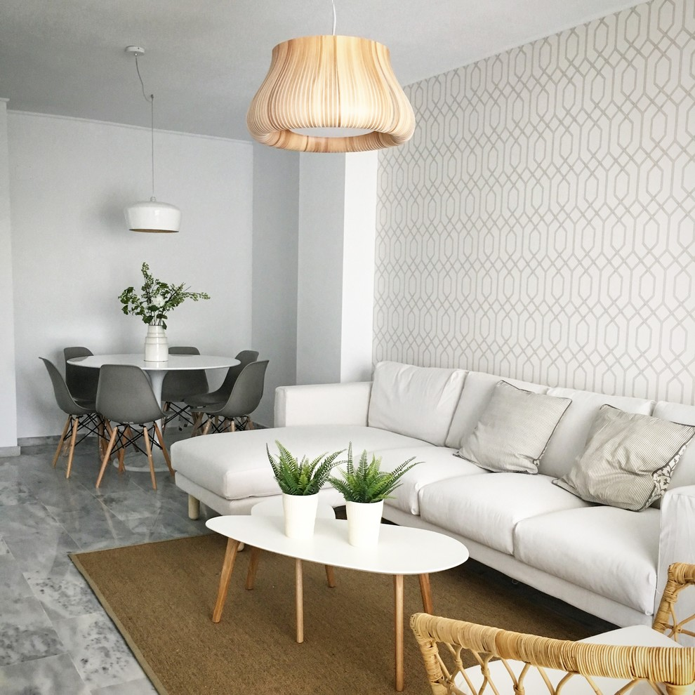 Living room - scandinavian open concept gray floor living room idea in Malaga with multicolored walls