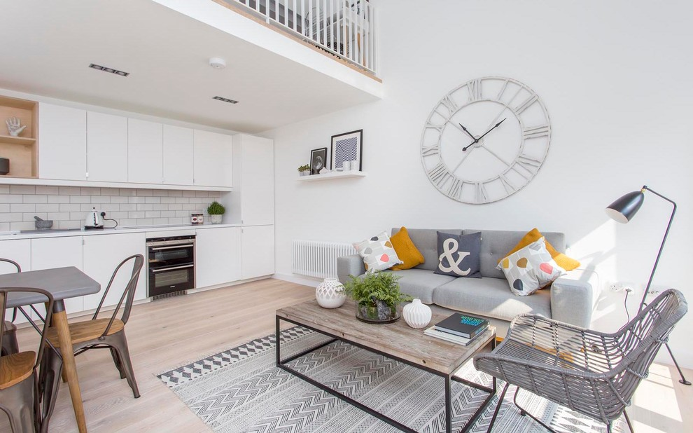 Mid-sized danish open concept light wood floor living room photo in Barcelona with white walls and no fireplace