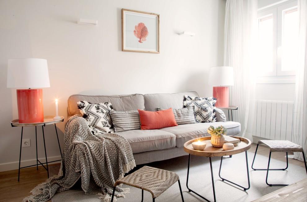Living room - scandinavian formal medium tone wood floor and beige floor living room idea in Bilbao with white walls