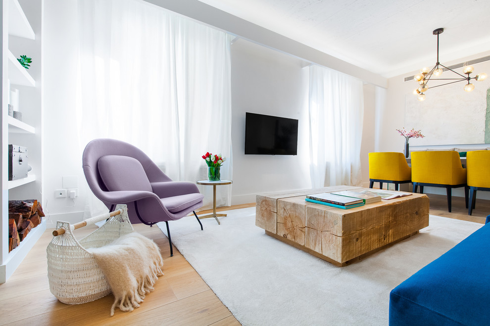 Example of a large trendy formal and open concept light wood floor living room design in Madrid with white walls, a wall-mounted tv and no fireplace