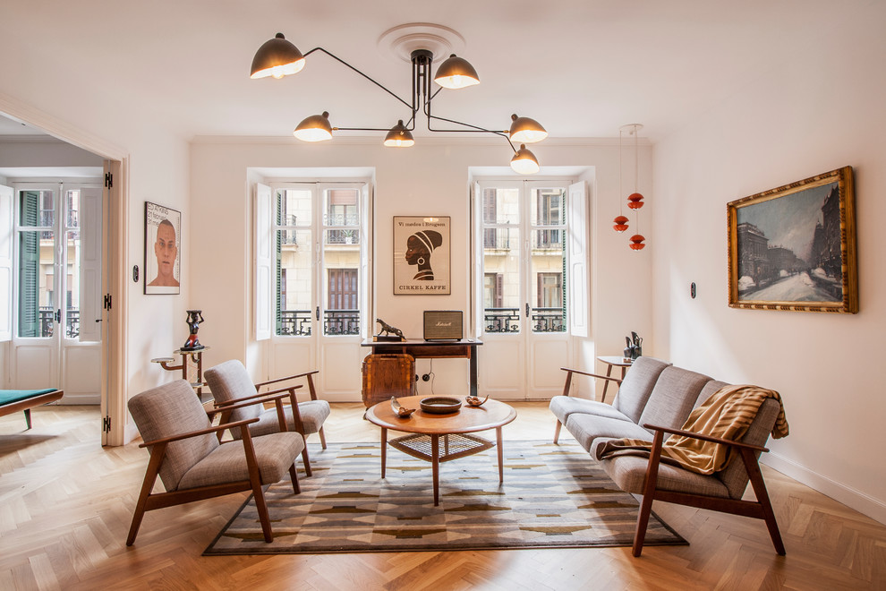 Danish medium tone wood floor and brown floor living room photo in Other with white walls