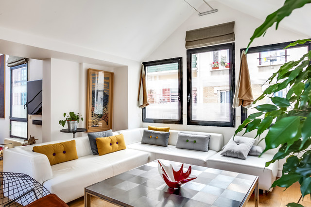 Mid-sized trendy open concept light wood floor living room photo in Paris with white walls and a wall-mounted tv