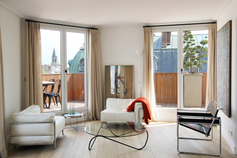 Living room - small modern enclosed light wood floor living room idea in Paris with white walls, no fireplace and no tv