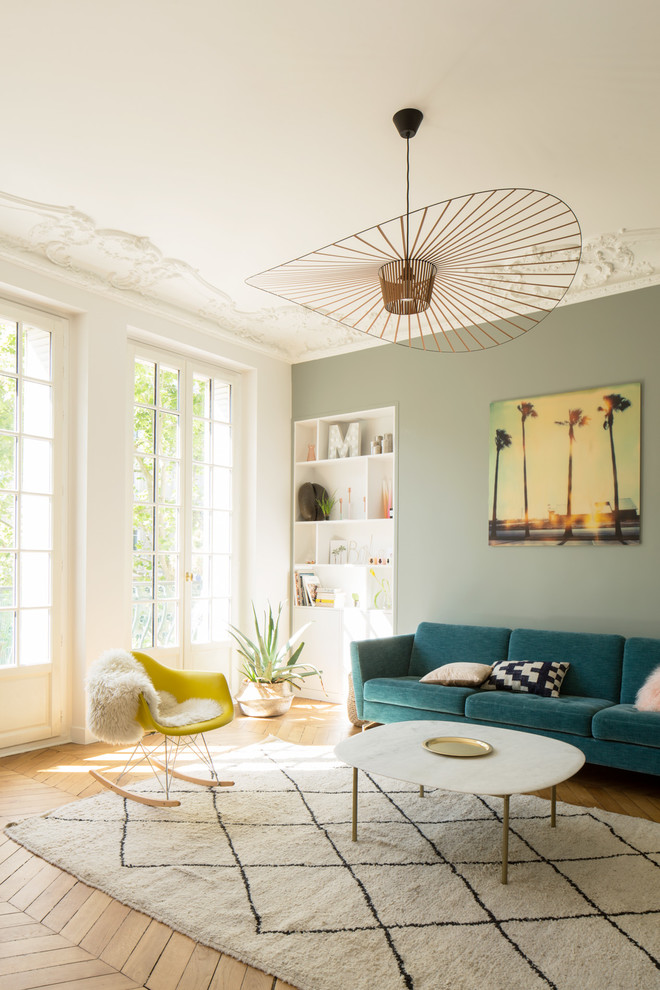 Inspiration for a large scandinavian open concept medium tone wood floor and brown floor living room remodel in Paris with white walls