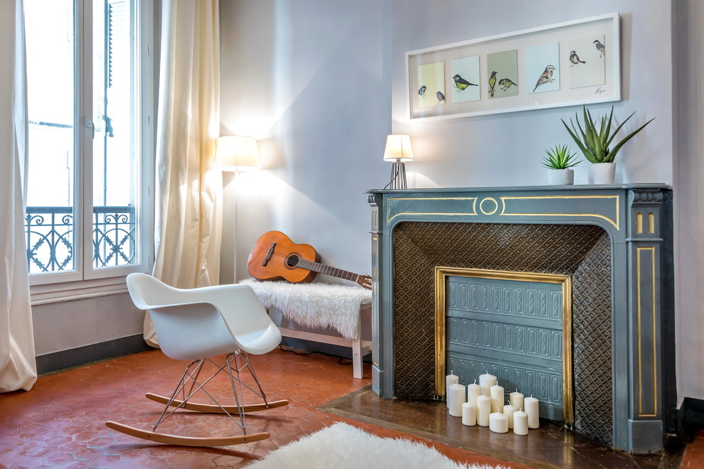 Living room - mid-sized transitional enclosed terra-cotta tile living room idea in Marseille with gray walls, a standard fireplace, a stone fireplace, no tv and a music area