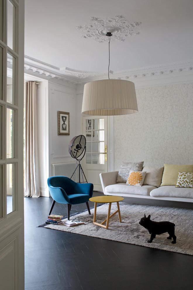 Living room - scandinavian dark wood floor living room idea in Nice with beige walls