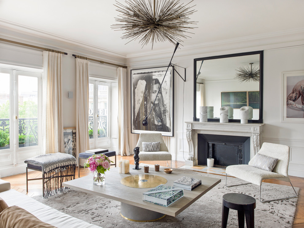 Inspiration for a large contemporary formal and enclosed medium tone wood floor living room remodel in Paris with white walls, a standard fireplace, a stone fireplace and no tv