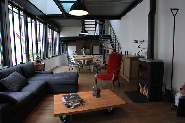 Photo Of An Industrial Living Room In Paris.