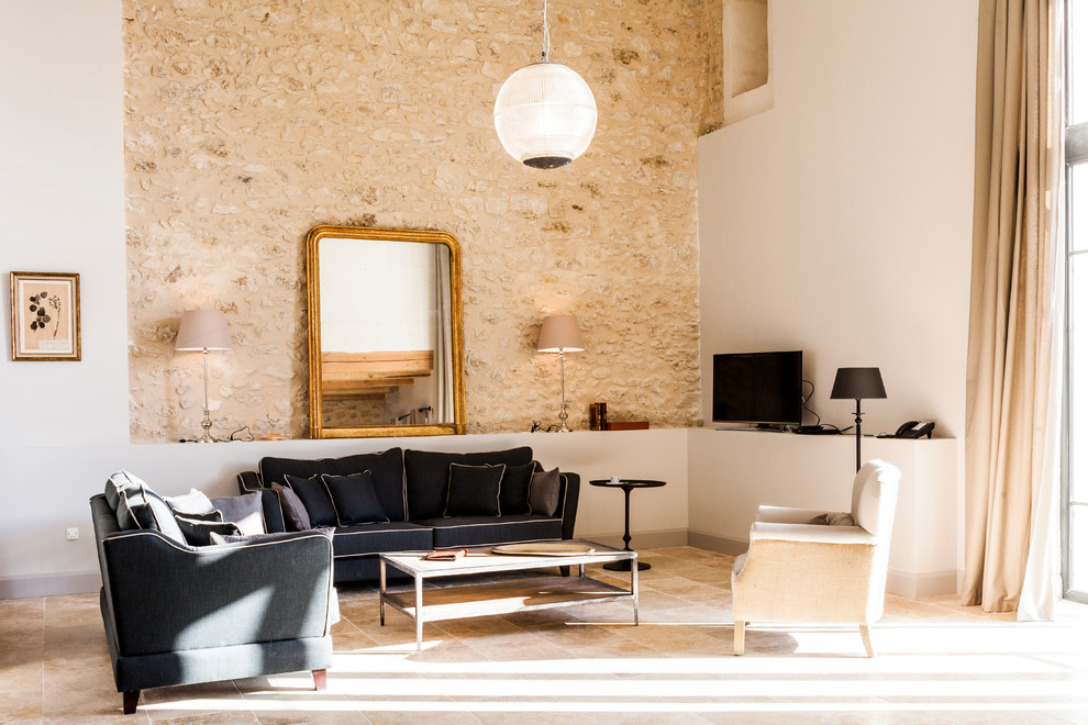 Inspiration for a country formal and open concept beige floor living room remodel in Montpellier with multicolored walls and a tv stand
