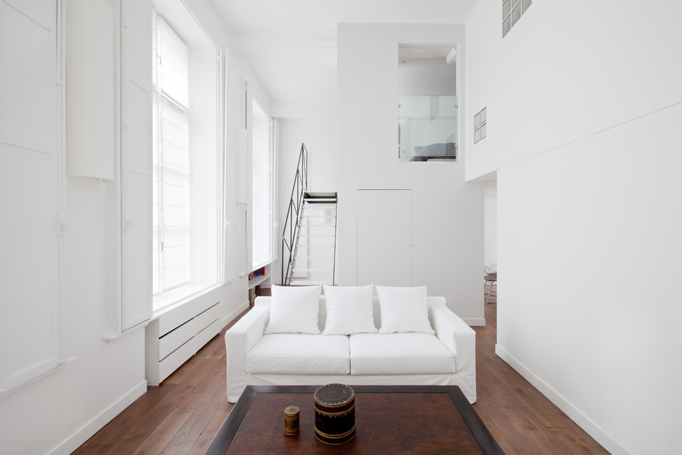 Inspiration for a small modern formal and open concept medium tone wood floor living room remodel in Paris with white walls, no fireplace and no tv