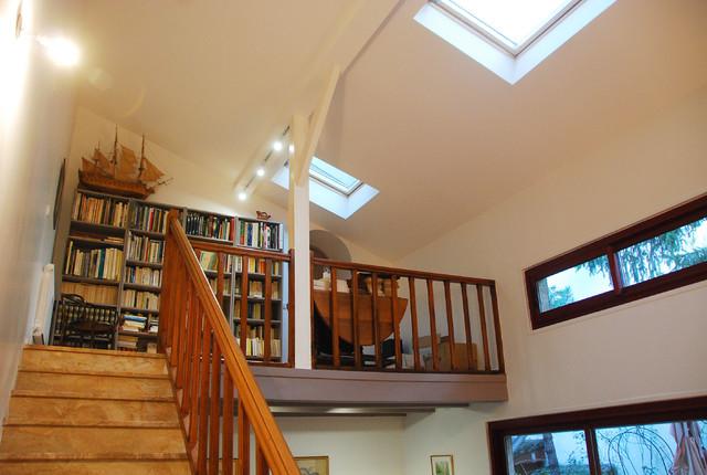 Grande Hauteur Sous Plafond rénovation d'un salon avec grande hauteur sous plafond