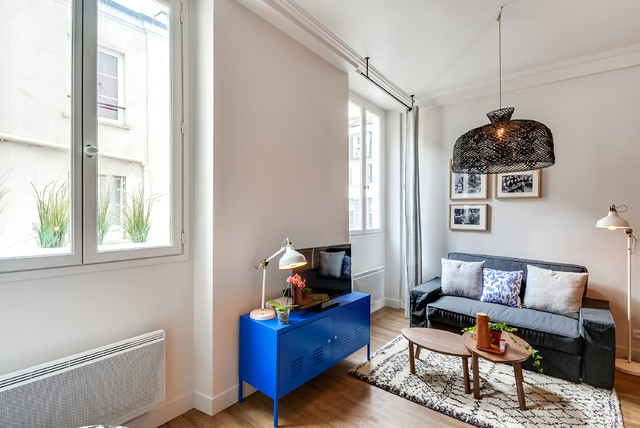 R novation d 39 un studio de 25m2 dans le marais for Amenagement sejour cuisine 25m2