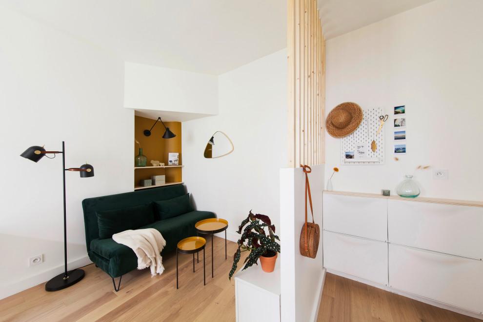 Living room - small scandinavian open concept living room idea in Paris with no tv
