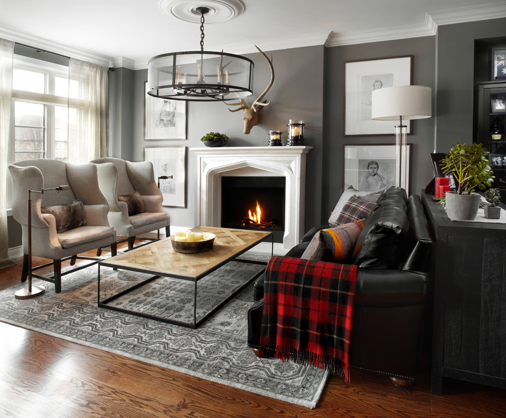 Example of a mid-sized transitional formal and open concept medium tone wood floor living room design in Paris with gray walls, a standard fireplace and no tv
