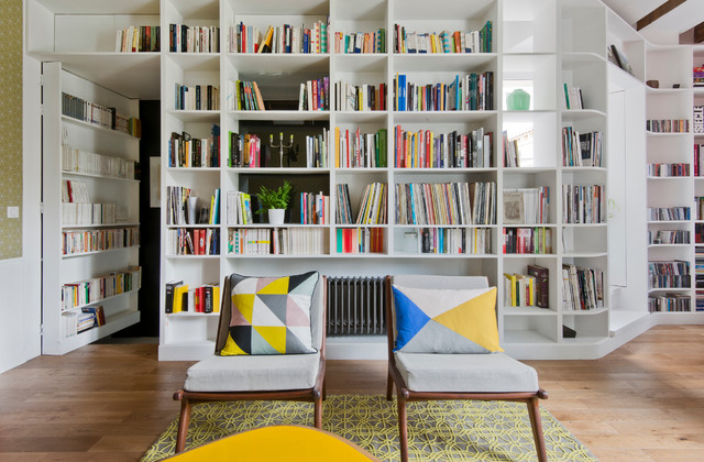 Medium sized scandi enclosed living room in Paris with a reading nook, white walls, light hardwood flooring, no fireplace and no tv.