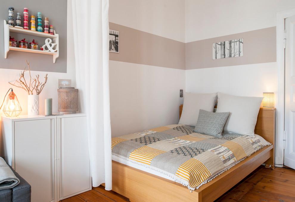 Bedroom - small scandinavian loft-style light wood floor bedroom idea in Berlin with white walls