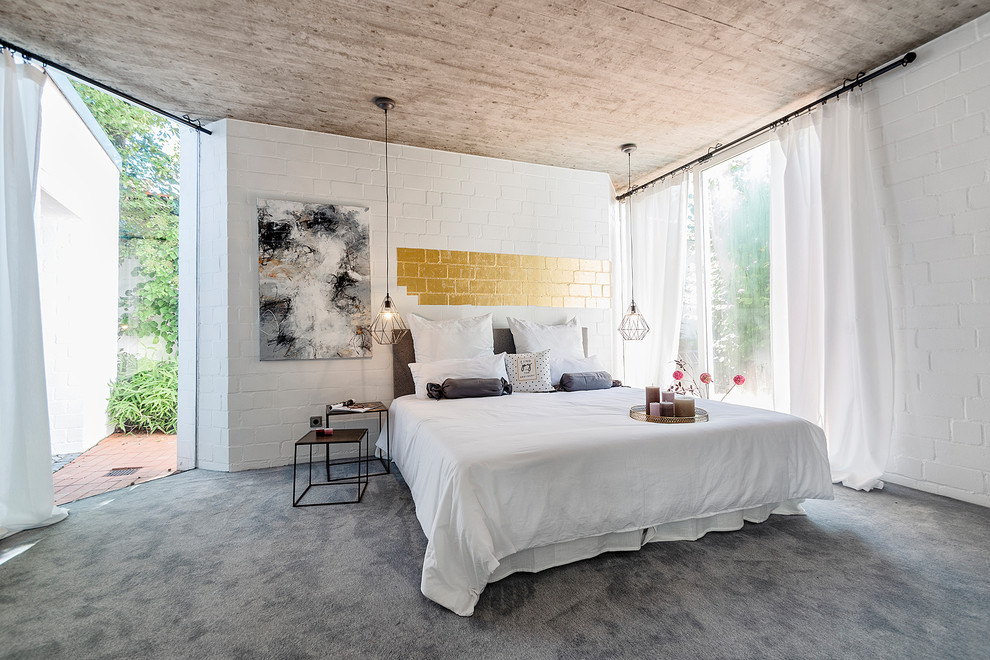 Example of a large trendy master carpeted and gray floor bedroom design in Other with white walls and no fireplace