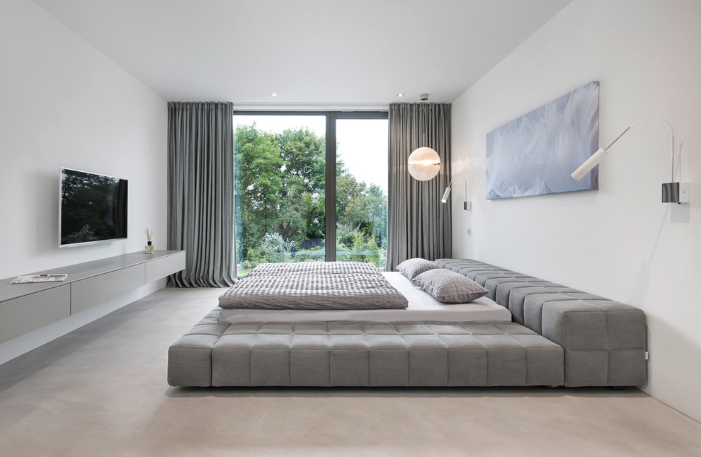 Inspiration for a large modern master carpeted bedroom remodel in Nuremberg with white walls and no fireplace