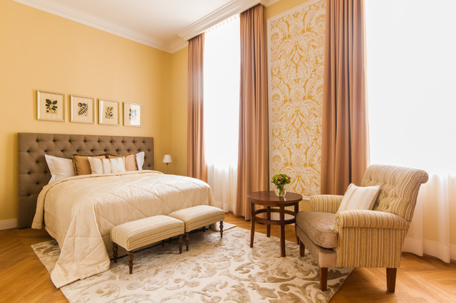 Large elegant master light wood floor bedroom photo in Other with yellow walls and no fireplace