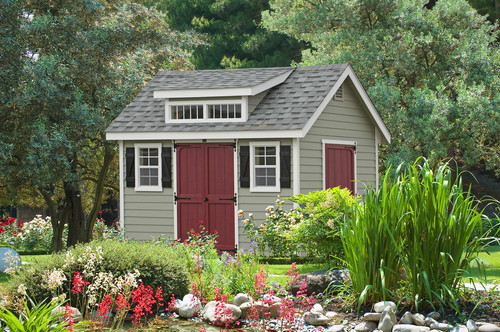 Simple shed with dusky red doors.